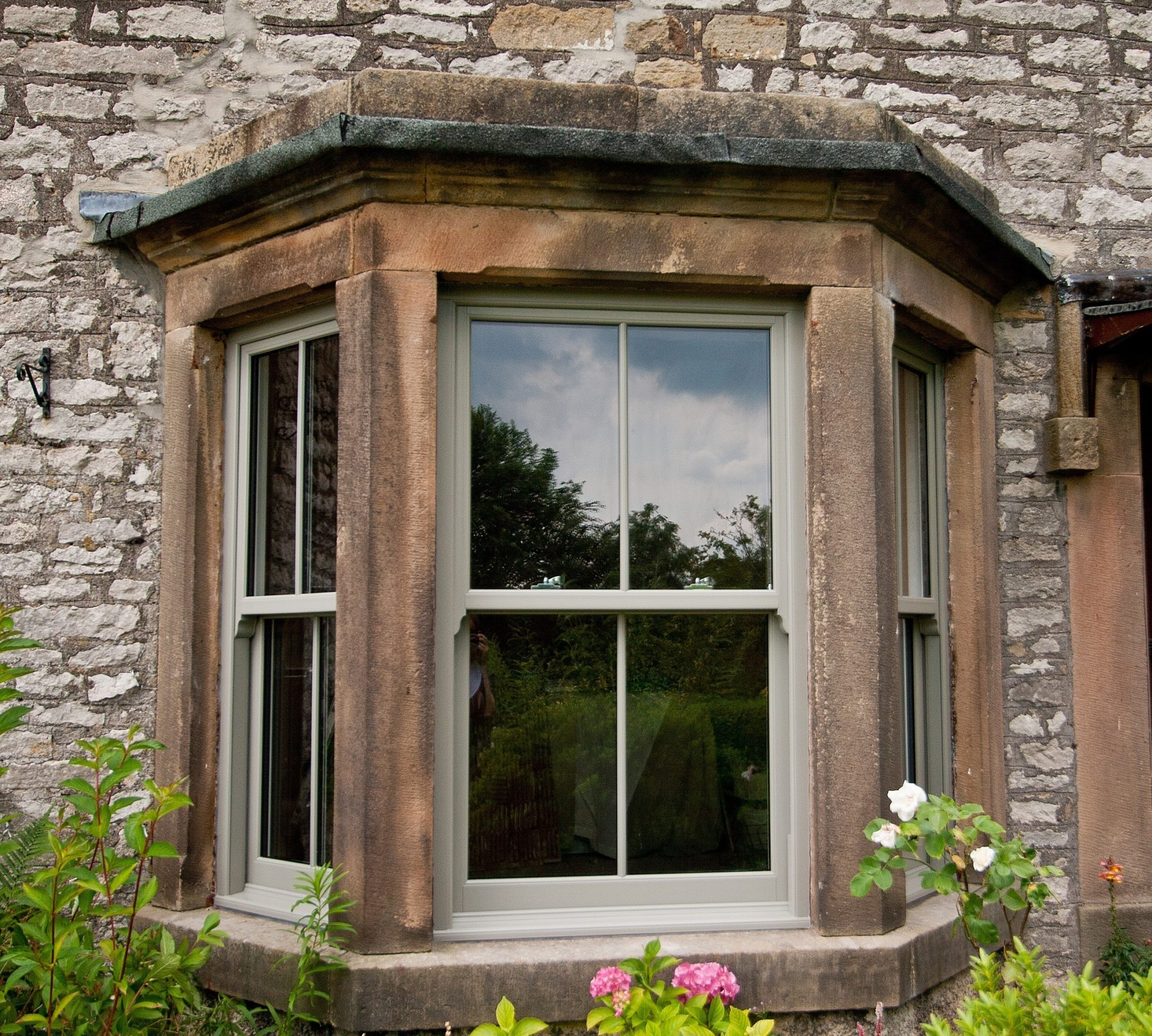 stone bay sash window